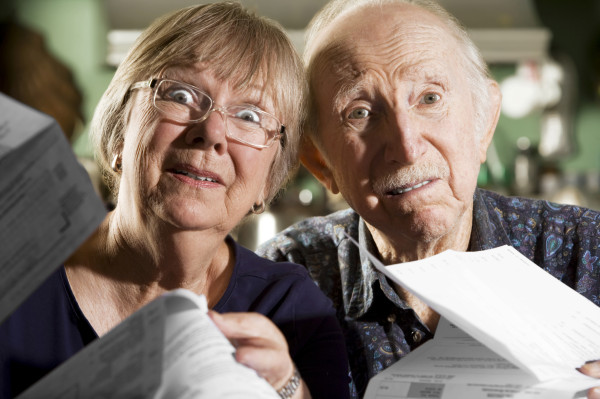 Elder Couple with Bills