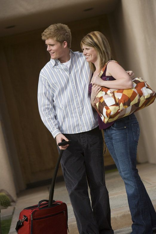 http://www.dreamstime.com/royalty-free-stock-photography-couple-carrying-luggage-image29650457