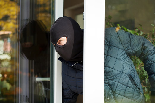 http://www.dreamstime.com/royalty-free-stock-photos-housebreaker-wearing-mask-loking-window-image35365138
